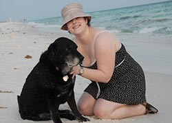 Dog rescue stories: Mary McNeight and her dog Jasper on the beach.
